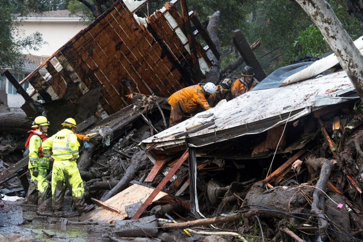 Emergency personnel prepare to rescue a trapped woman inside a collapsed house in Montecito, California.