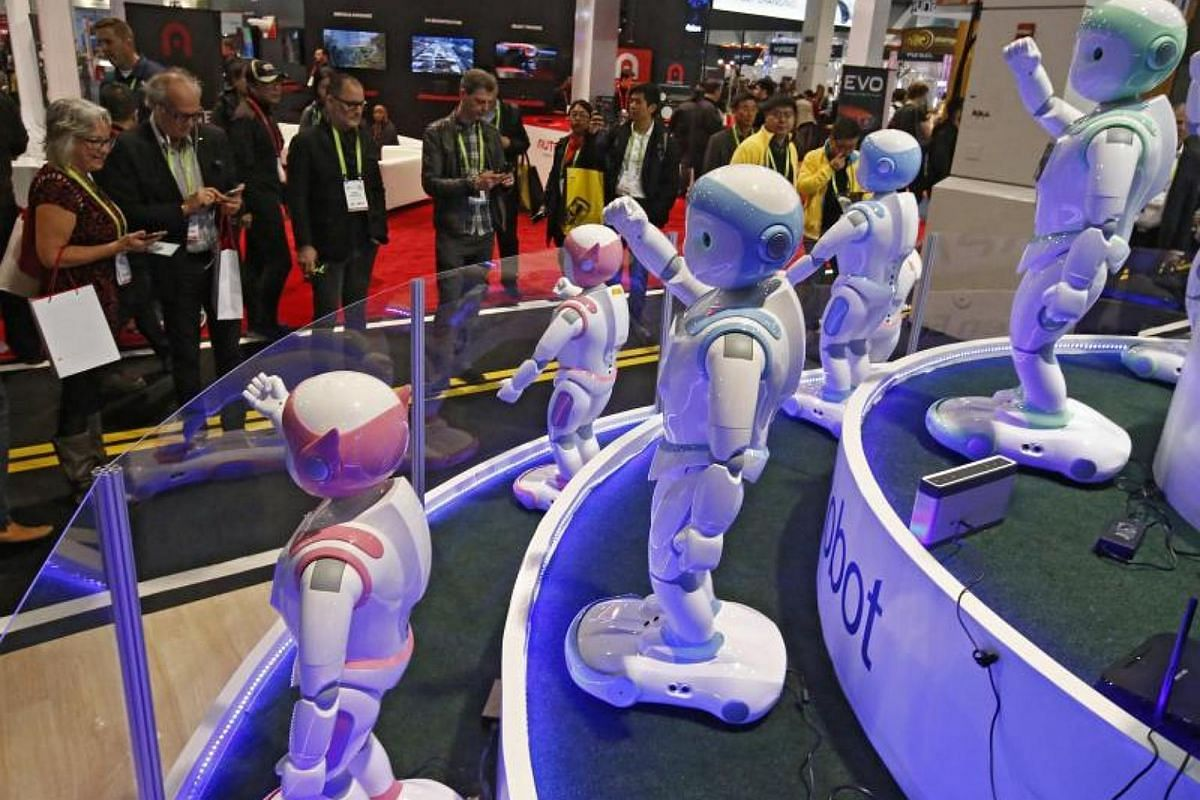 People look at robots by Avatarmind sits on display on opening day at the 2018 International Consumer Electronics Show in Las Vegas, Nevada, on Jan 9, 2018.
