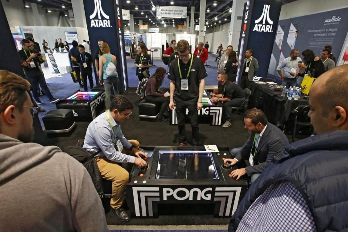 People play Pong the Atari game on opening day at the 2018 International Consumer Electronics Show in Las Vegas, Nevada, on Jan 9, 2018.