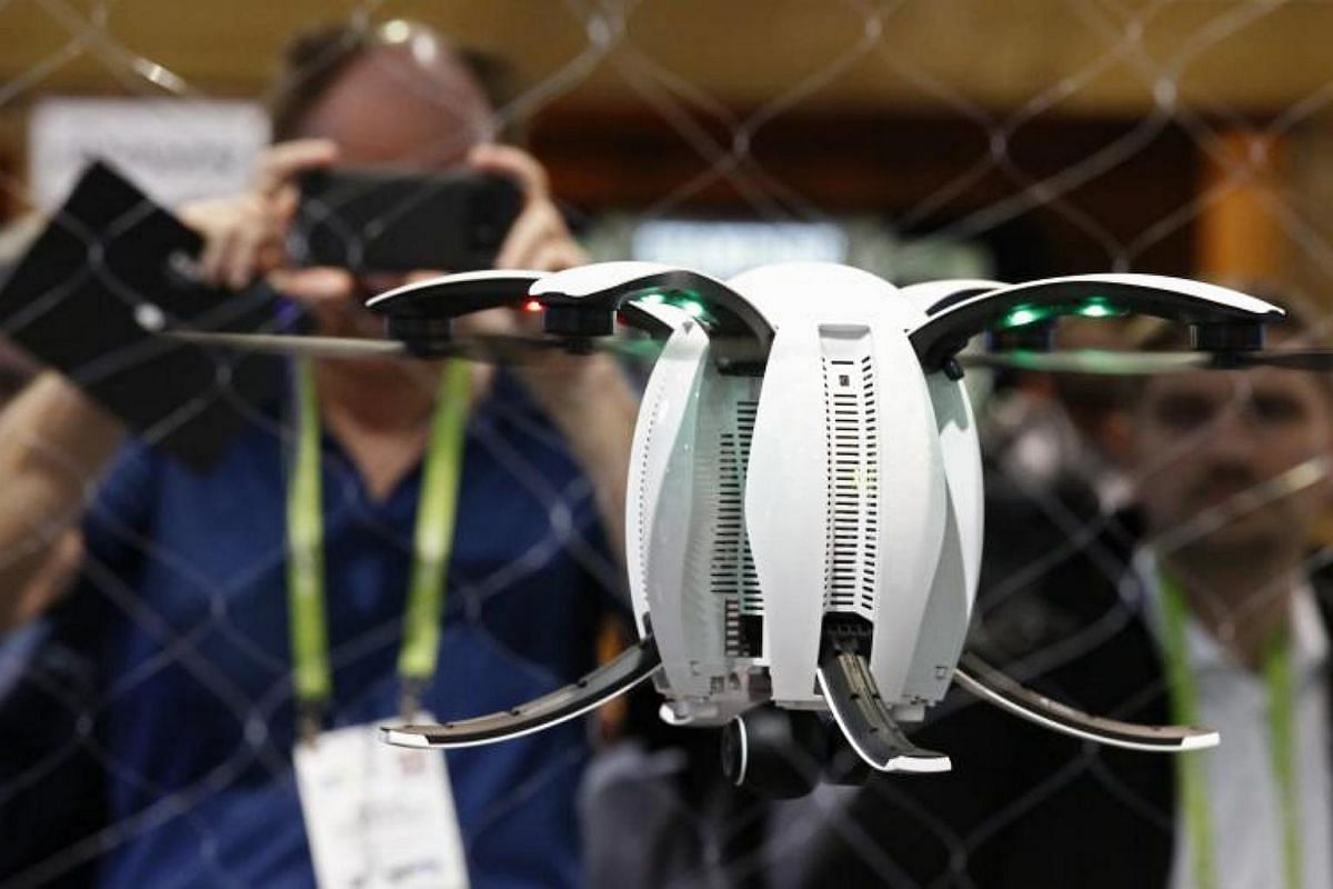 People watch a PowerVision Drone on opening day at the 2018 International Consumer Electronics Show in Las Vegas, Nevada, on Jan 9, 2018.