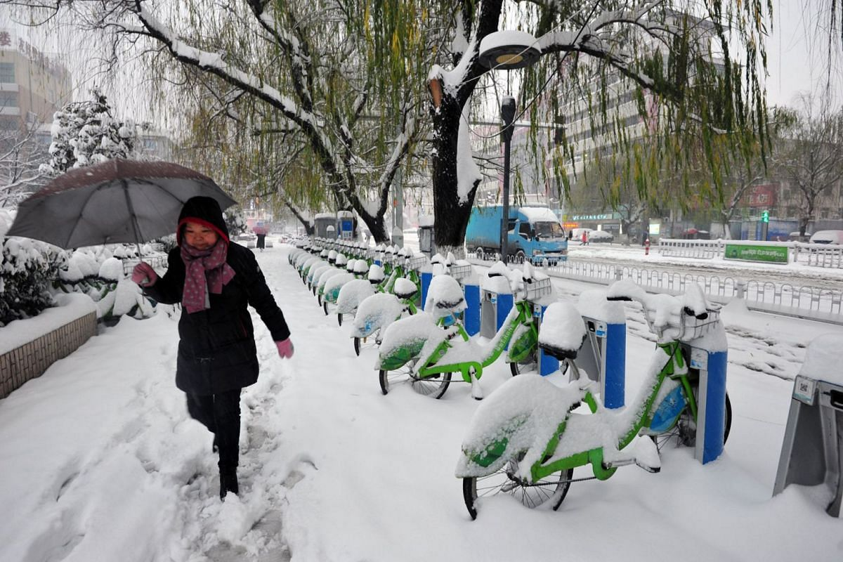 Meanwhile last Thursday in China, a woman braves the snow in Fuyang in central Anhui province, after snowstorms hit large parts of the country, causing train and flight cancellations and school closures as blizzards claimed the lives of ten people.
