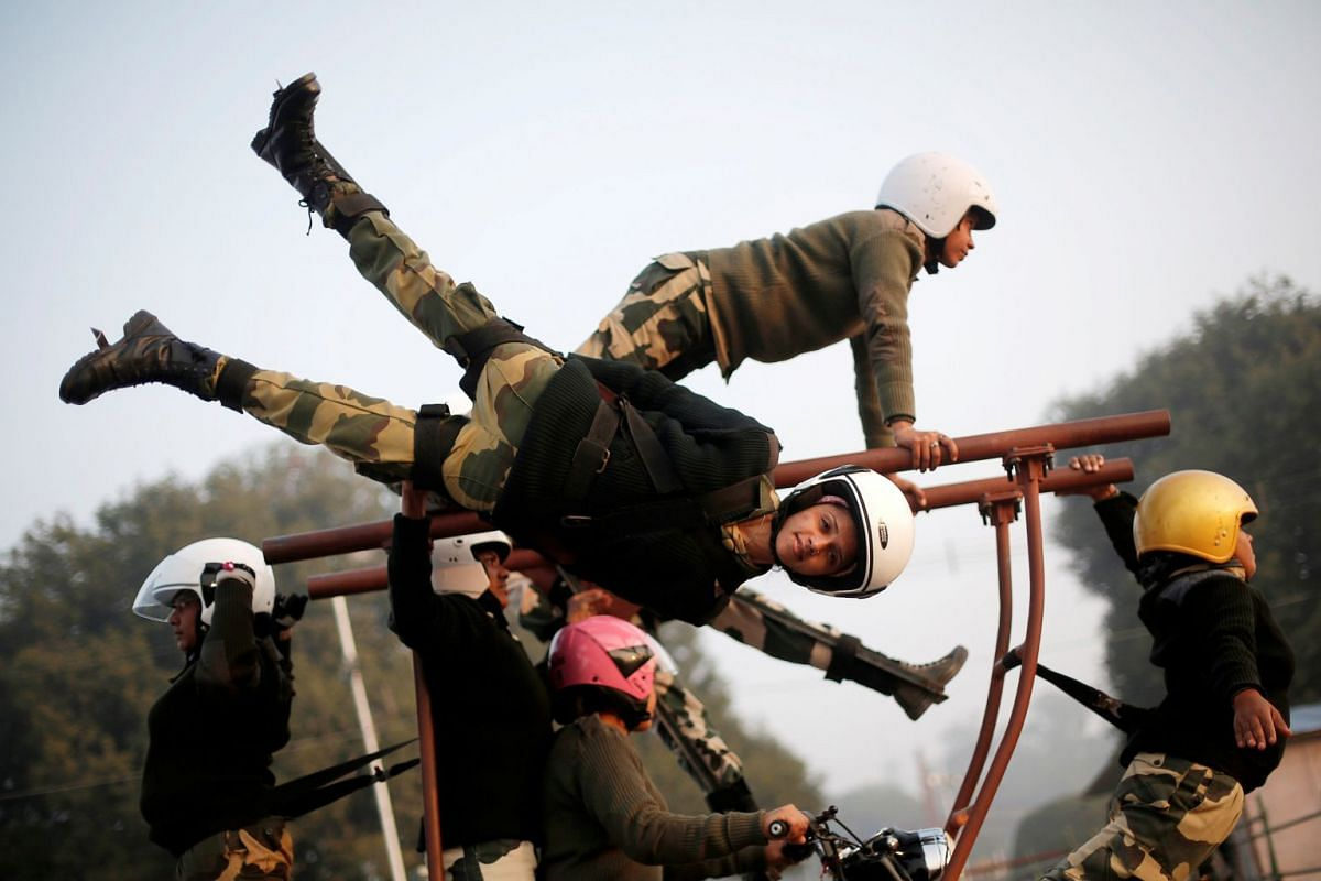 """India's Border Security Force (BSF) """"Daredevils"""" women motorcycle riders perform during a rehearsal for the Republic Day parade on a cold winter morning in New Delhi, India, January 10, 2018. PHOTO: REUTERS"""