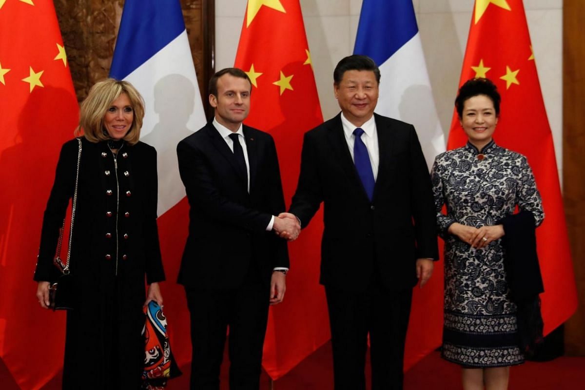 French president Emmanuel Macron and his wife Brigitte meet with Chinese President Xi Jinping and his wife Peng Liyuan at the Diaoyutai State Guesthouse in Beijing on Jan 8.