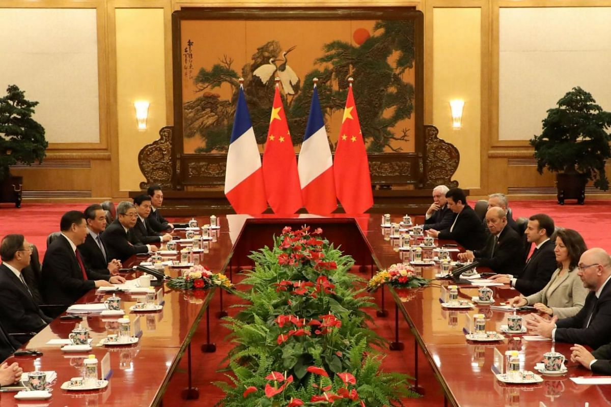 French president Emmanuel Macron speaks during a meeting with Chinese President Xi Jinping at the Great Hall of the People in Beijing, China, on Jan 9.