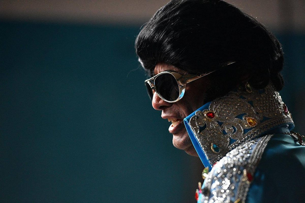 An Elvis impersonator is seen before boarding the Elvis Express at Central Station in Sydney, on Jan 11, 2018.