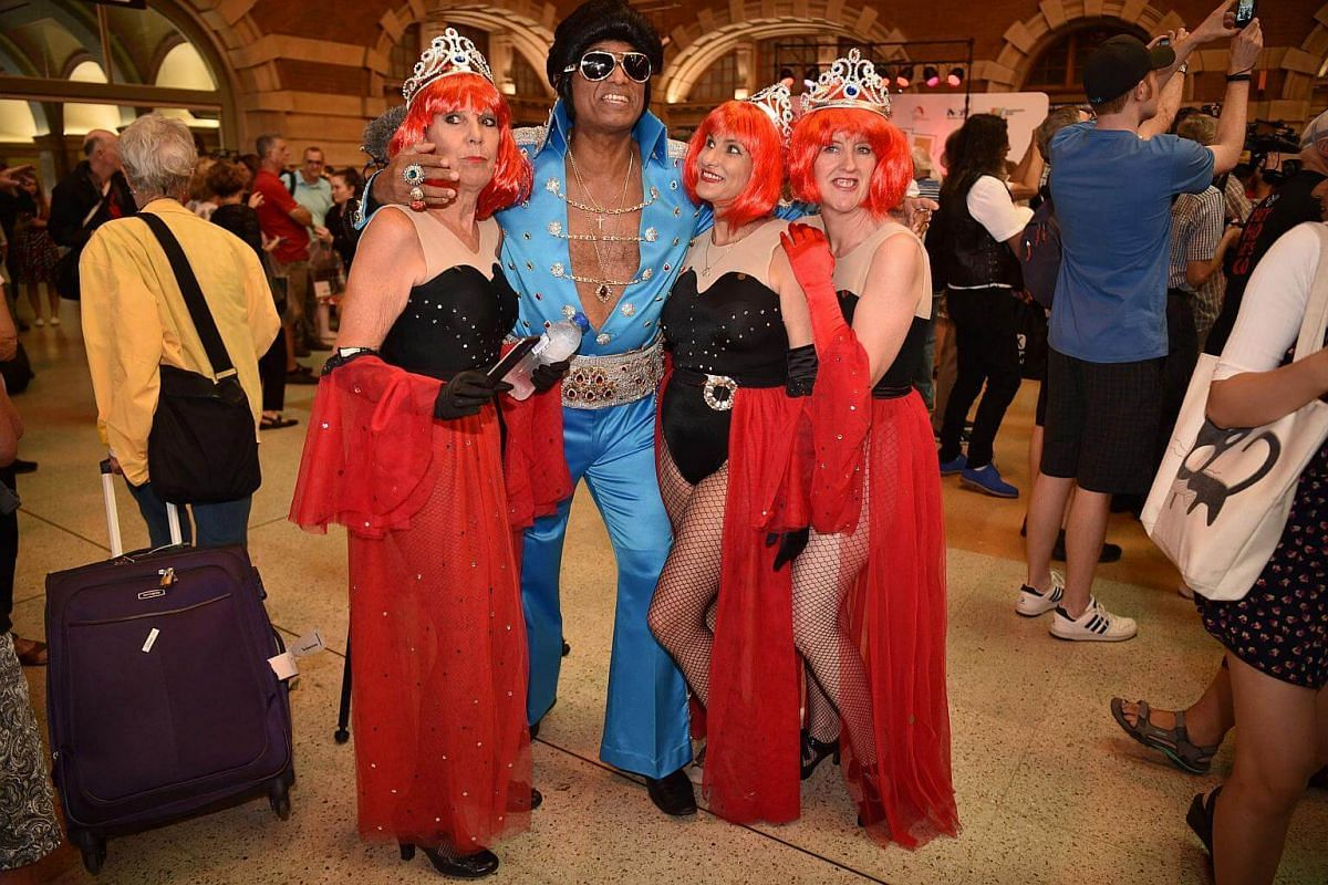 Elvis fans arrive at Central station to board a train to The Parkes Elvis Festival in Sydney on Jan 11, 2018.