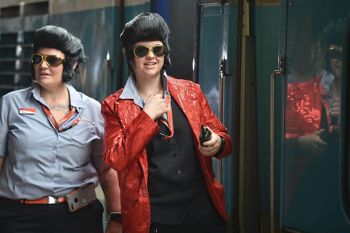 Train conductors dressed as Elvis wait for the train to leave Central station to take people to the Parkes Elvis Festival in Sydney on Jan 11, 2018.