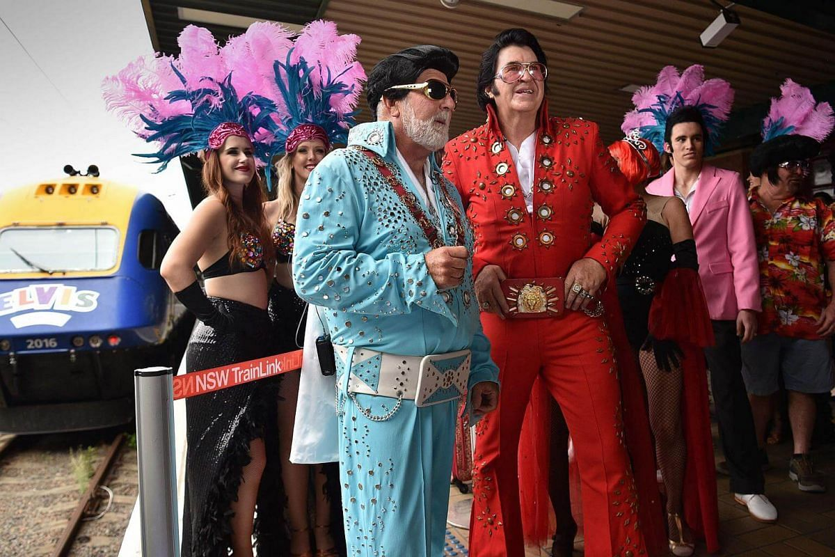 Elvis fans arrive at Central station before boarding a train to The Parkes Elvis Festival in Sydney on Jan 11, 2018.