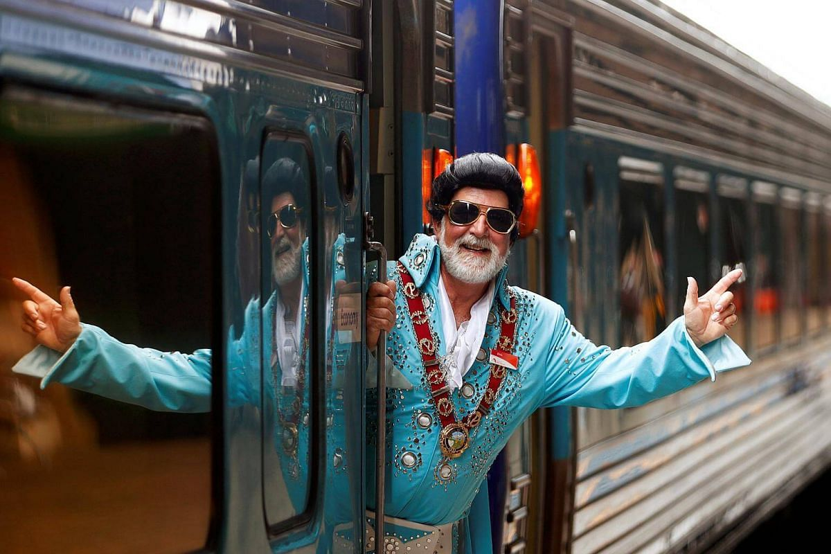 Elvis Presley impersonator and Mayor of the town of Parkes, Ken Keith, stands aboard the Elvis Express train at Sydney's Central station before it departs for the 26th annual Elvis Festival in Parkes, Australia, on Jan 11, 2018.