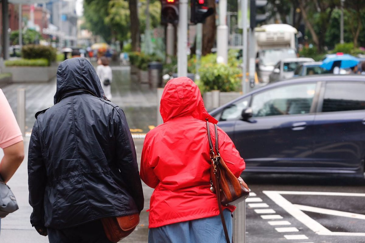 A couple in hoodies along Orchard Road on Jan 12, 2018.