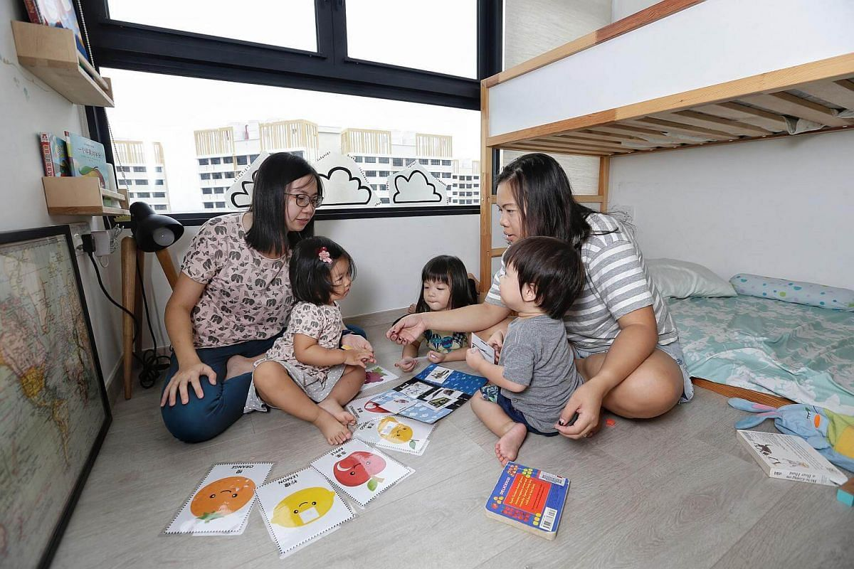 Housewife Sylvia Lye (far left) and teacher Tiffany Lim (left) prepare varied home-learning activities for their children - (second from far left) Alison Lye, three, Chloe Lim, four, and Joash Lim, two.