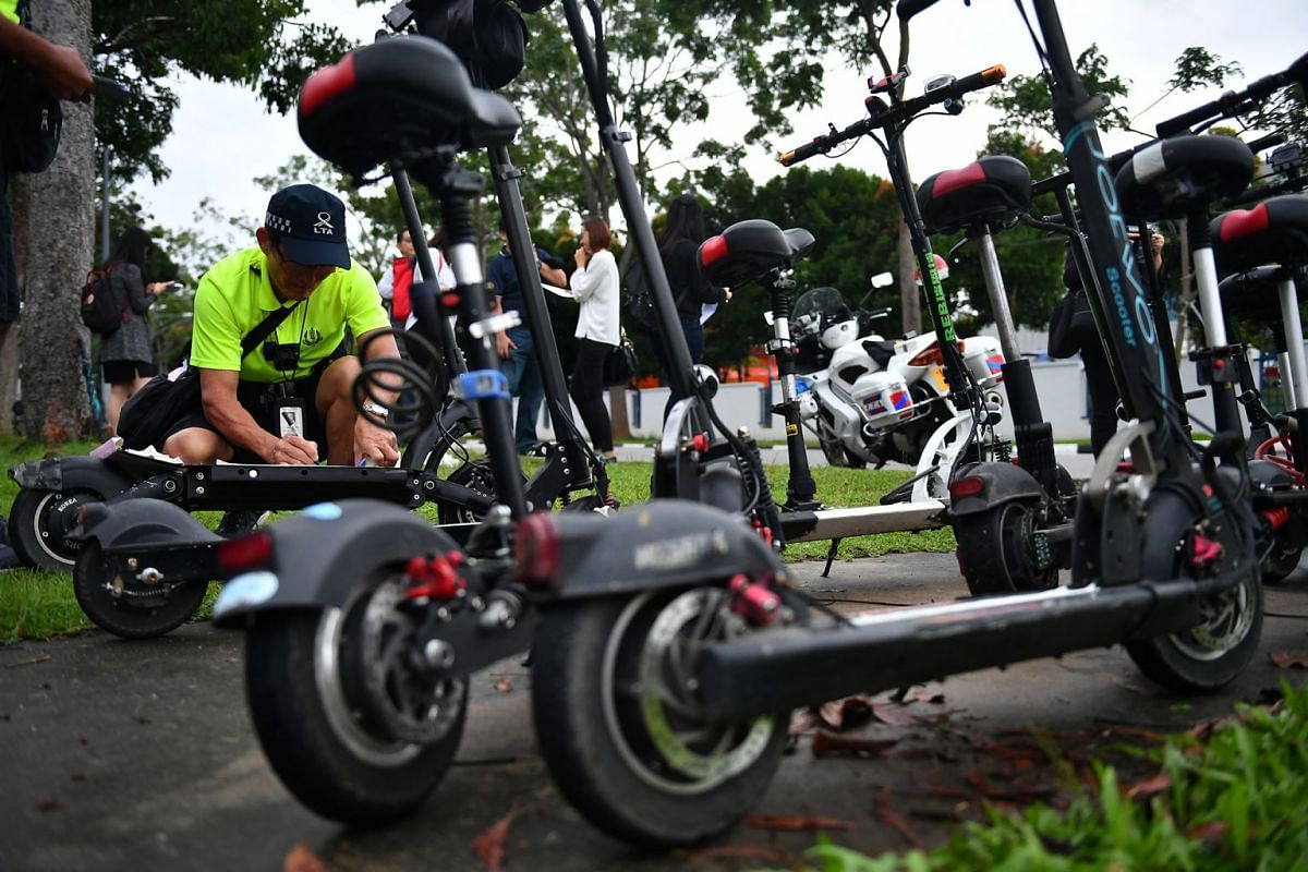 The Land Transport Authority conducting enforcement operations against personal mobility device users caught riding on the road at Loyang Drive on Jan 15, 2018, as stiffer penalties for the offence come into effect.