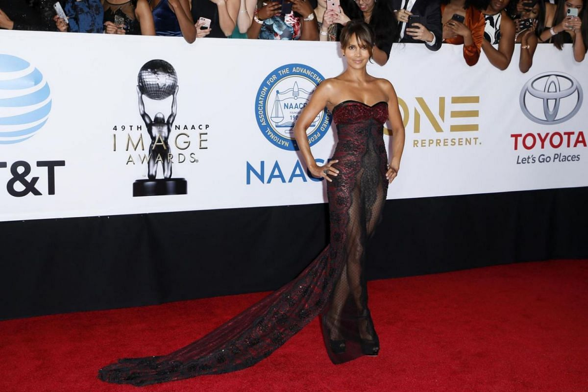 Oscar winning actress Halle Berry poses on the red carpet for the NAACP awards.
