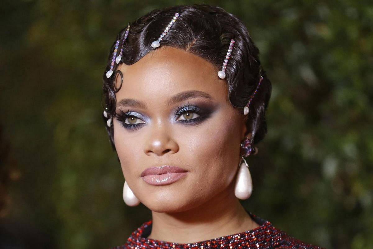 Singer Andra Day on the other hand opts for beaded pins for her slicked back take on a flapper girl do.