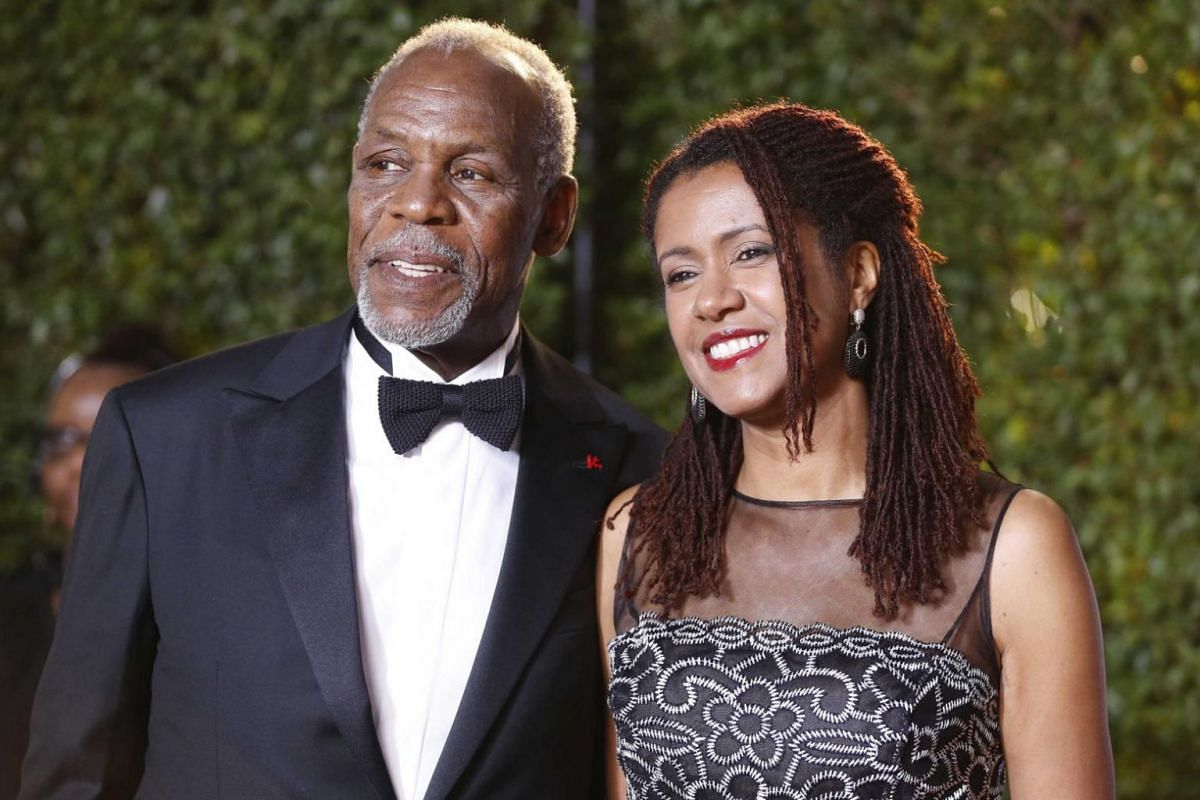 Actor Danny Glover and his guest arrive on the red carpet.