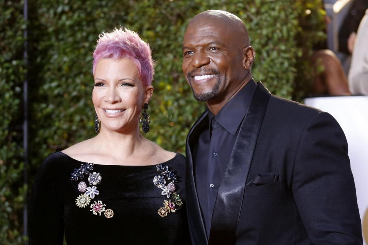 Actor Terry Crews and his wife Rebecca King-Crews arrive on the red carpet.