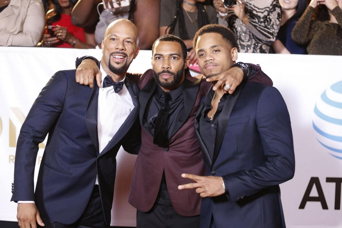 From left: Rapper Common, actors Omari Hardwick and Tristan Wilds pose for the cameras.