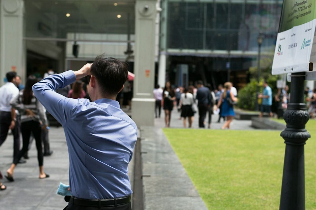A man wiping his sweat during lunch hour at Raffles Place on Jan 16.
