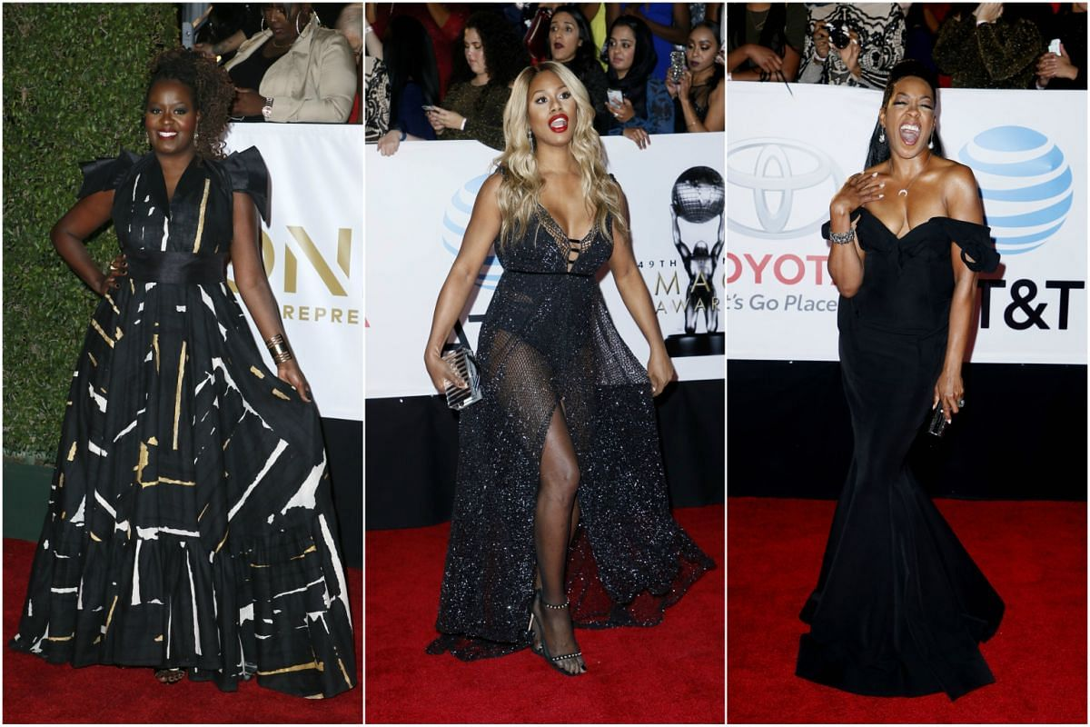 Singer Somi and actresses Laverne Cox and Tichina Arnold pose for the cameras on the red carpet.