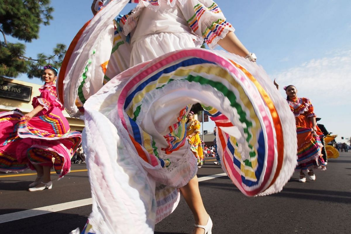 Members of the Cathedral City High School Ballet Folklorico dance in the 33rd annual Kingdom Day Parade honoring Dr. Martin Luther King Jr., January 15, 2018 in Los Angeles, California. The theme of this year's parade is ``When They Go Low, We Go Hi