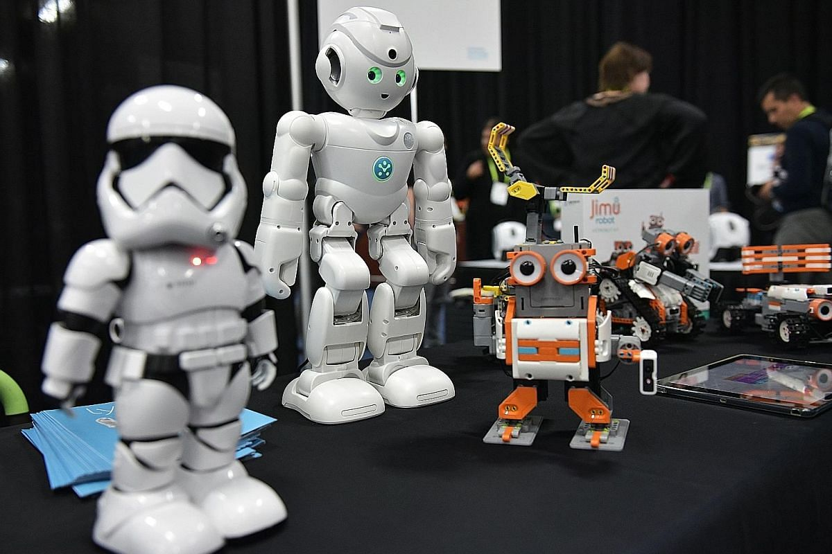"Ubtech robots including the First Order ""Stormtrooper"" (left) and the Amazon Alexa voice assistant enabled ""lynx"" (centre) at CES 2018 in Las Vegas."