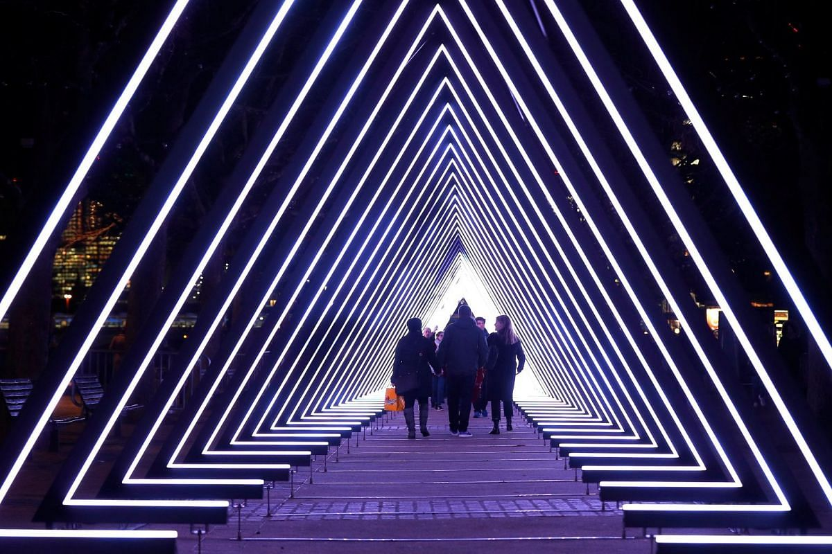 Visitors to the South Bank walk through The Wave, by Vertigo, one of several light installations placed around the capital which together form the Lumiere London festival, in London, Britain, January 17, 2018