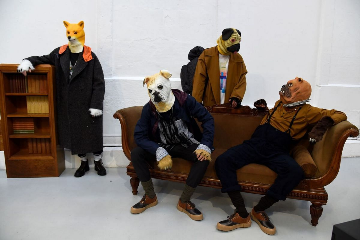 Models present creations by Julien David for the Fall/Winter 2018/2019 collection as part of the men's Fashion Week in Paris on January 17, 2018.
