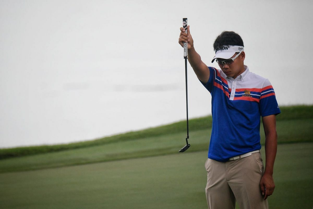 Tirawat Kaewsiribandit of Thailand lining up a shot during the first day of the SMBC Singapore Open.