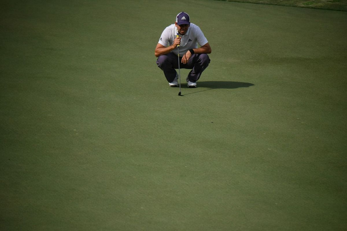 Sergio Garcia of Spain lining up a shot during the first day of the SMBC Singapore Open.