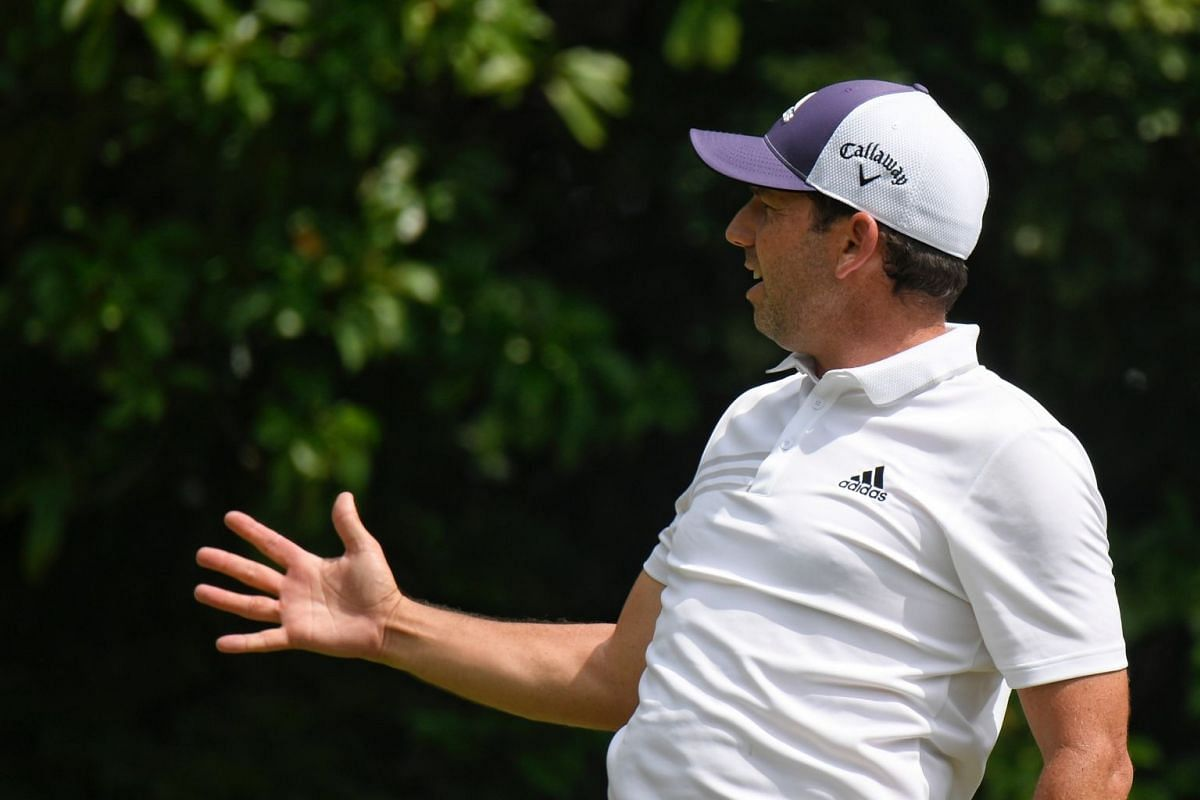 Sergio Garcia gesturing to spectators after teeing off during the first day of the SMBC Singapore Open. He would end the day as one of four tied at the top of the leaderboard.
