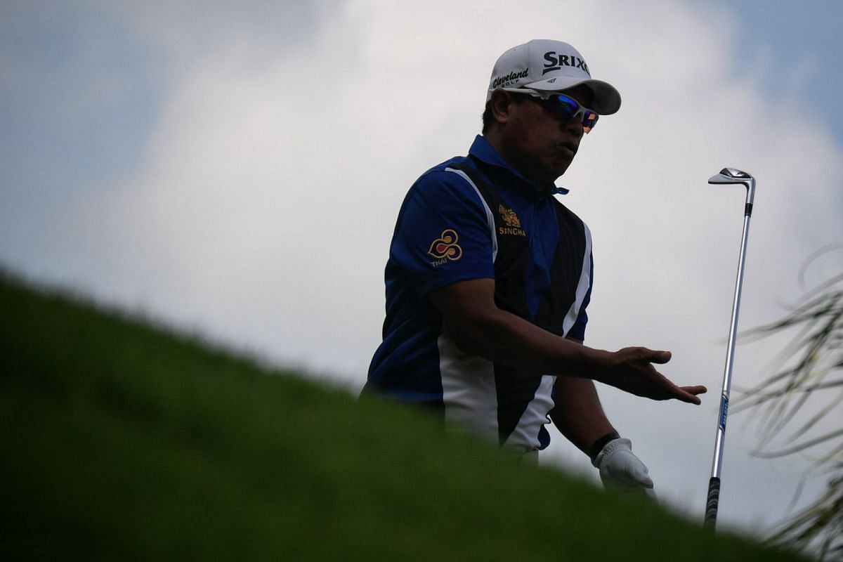 Prayad Marksaeng of Thailand tossing his golf club after teeing off during the first day of the SMBC Singapore Open.