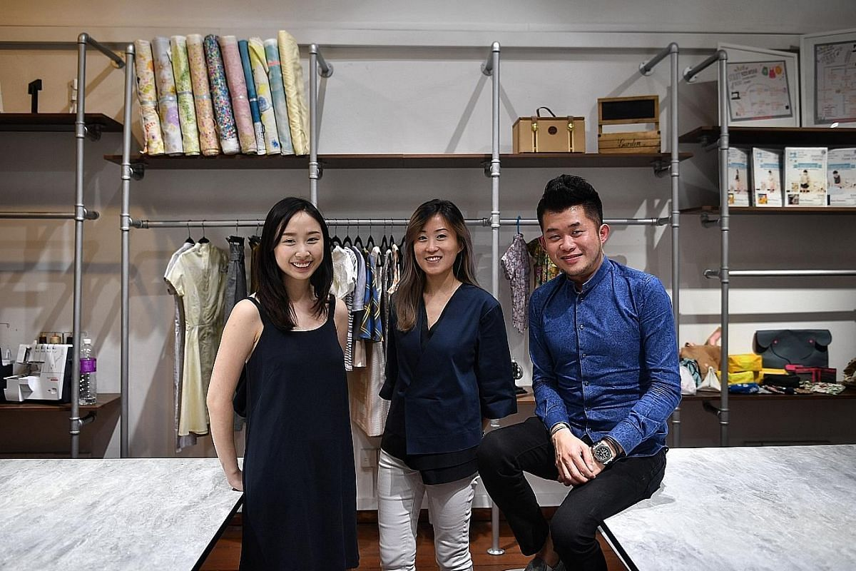 Ms Linda Ng and her daughter, Ms Lorencia Kan, wearing cheongsam that Ms Ng made. Fashion Makerspace, founded by (from left) Ms Hailey Lim, Ms Shareen Lim and Mr Ken Low, offers classes from basic sewing to pattern making.