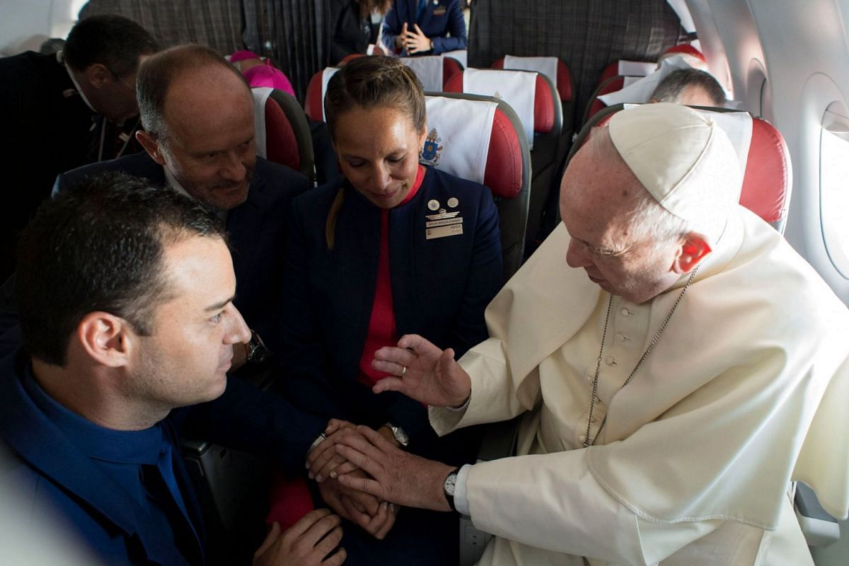 Pope Francis married the couple aboard the papal plane as it flew over Chile on the third day of his South American trip. Francis formally joined in matrimony 41-year-old Carlos Ciuffardi and Paula Podest, 39, who have two children. The Chilean coupl