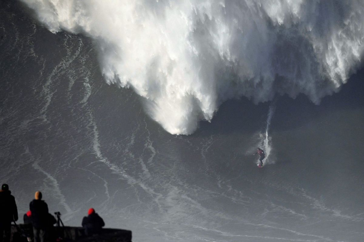 Australian big wave surfer Ross Clarke-Jones drops a wave during a surf session in Praia do Norte in Nazare, central Portugal.