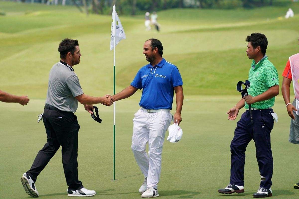 (From left) Louis Oosthuizen of South Africa, Shiv Kapur of India and Yuta Ikeda of Japan at Hole 9 during the second day of the SMBC Singapore Open.