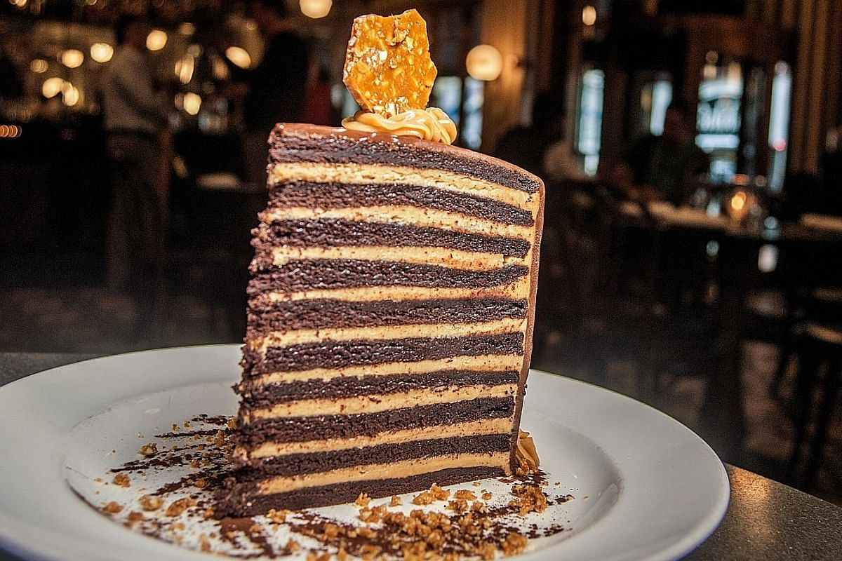 """The Meatball"" (left) is made with ground Imperial wagyu and Italian sausage and served with whipped ricotta. The 20 Layer Chocolate Cake (above) is a tower of chocolate devil's food cake stacked with peanut butter mascarpone."