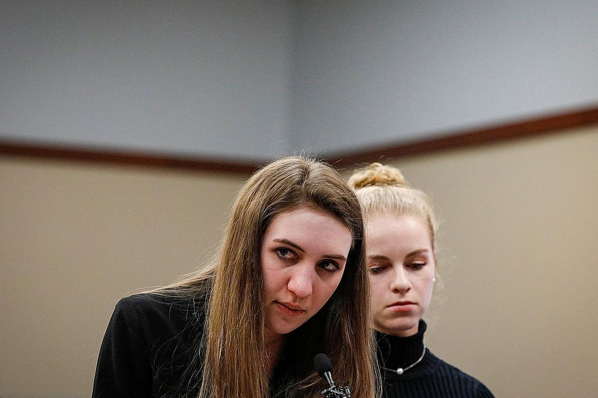 Former gymnast Lyndsy Carr (left) embracing her mother in court. Ms Carr was allegedly molested when she was 11 or 12 years old.