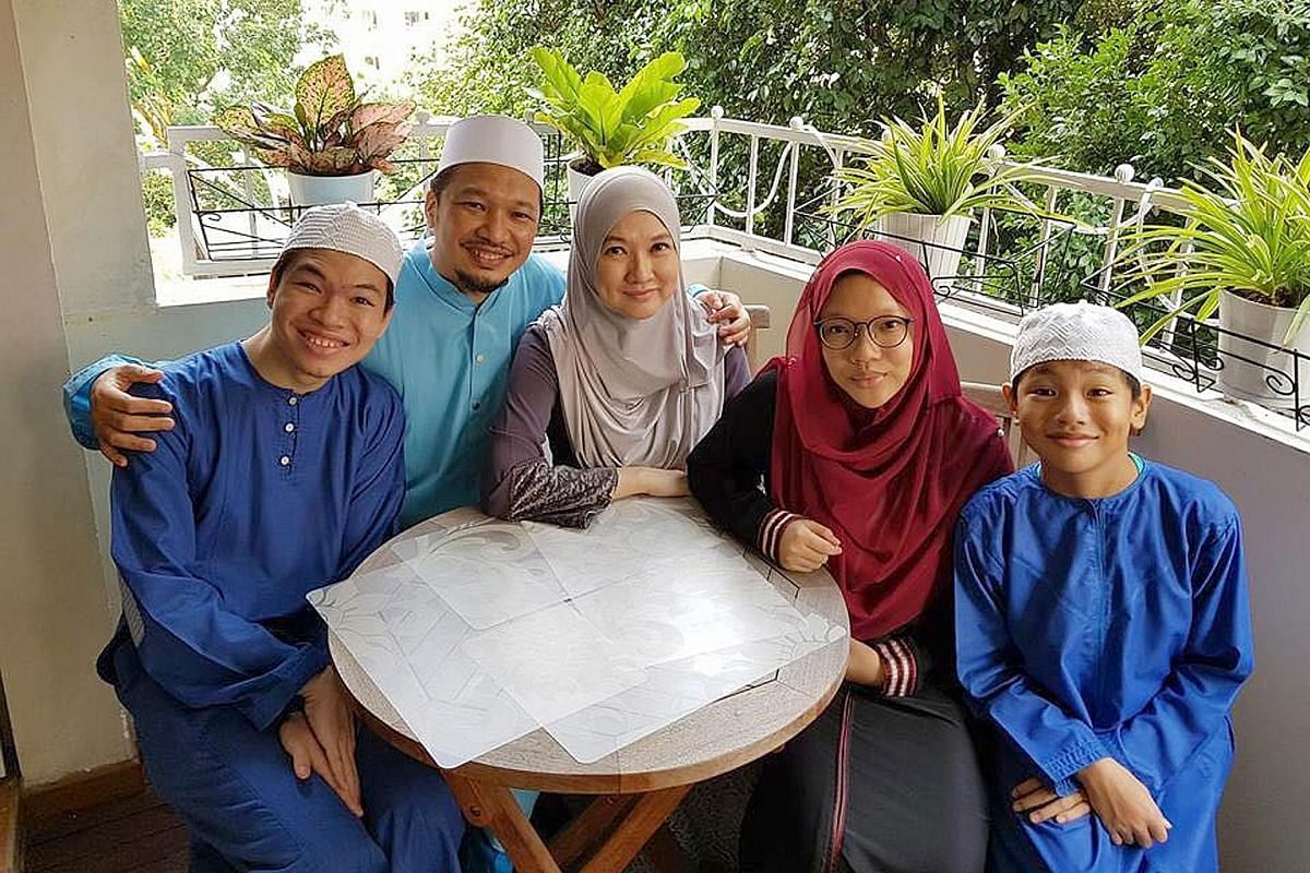 Mr Mohammad Ali Dawood and his wife, Ms Faraliza Zainal, with their children (from left) Mohammad Ashraf, Nur Aliah and Mohammad Adam.