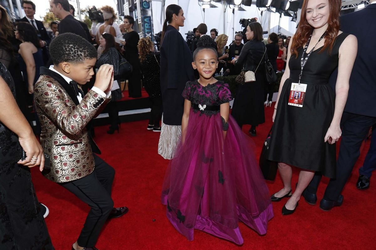 This Is Us actor Lonnie Chavis pretends to take a photo of fellow cast member Faithe Herman.