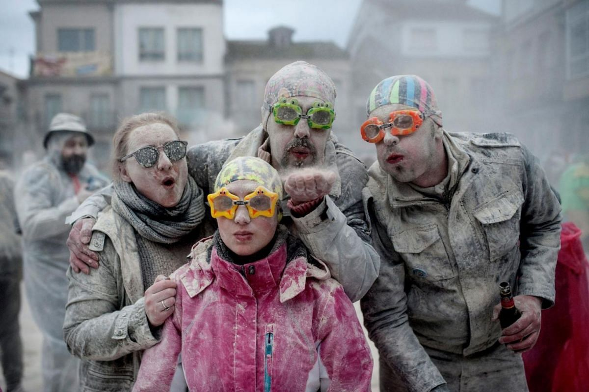 People attend the battle of flour, marking the beginning of the carnival celebrations in Xinzo de Limia, Galicia, north-western Spain, on Jan 21, 2018.