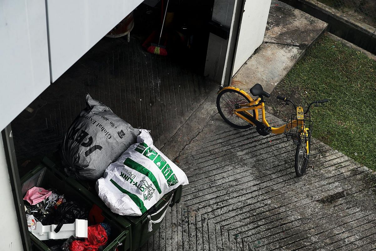 An ofo bicycle left at a trash collection point near Block 1004 Toa Payoh North, on Jan 1, 2018.