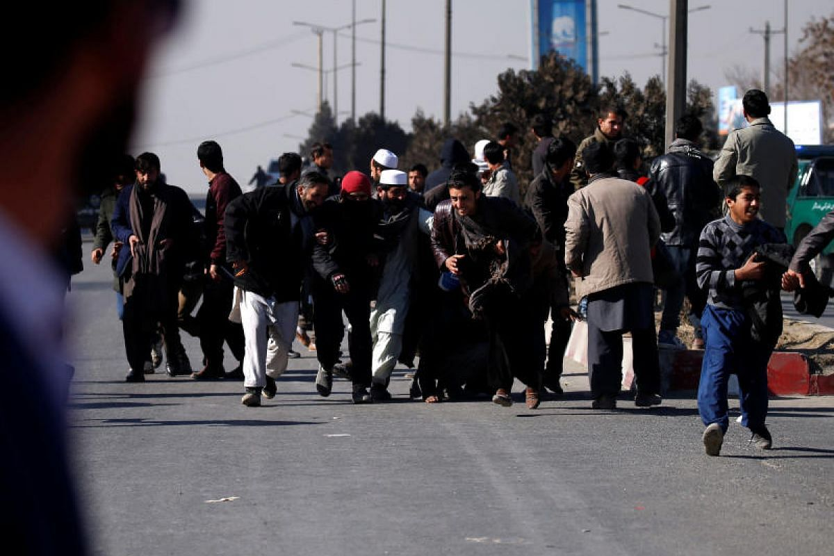 People escape during an attack on the Intercontinental Hotel in Kabul, Afghanistan on Jan 21, 2018.