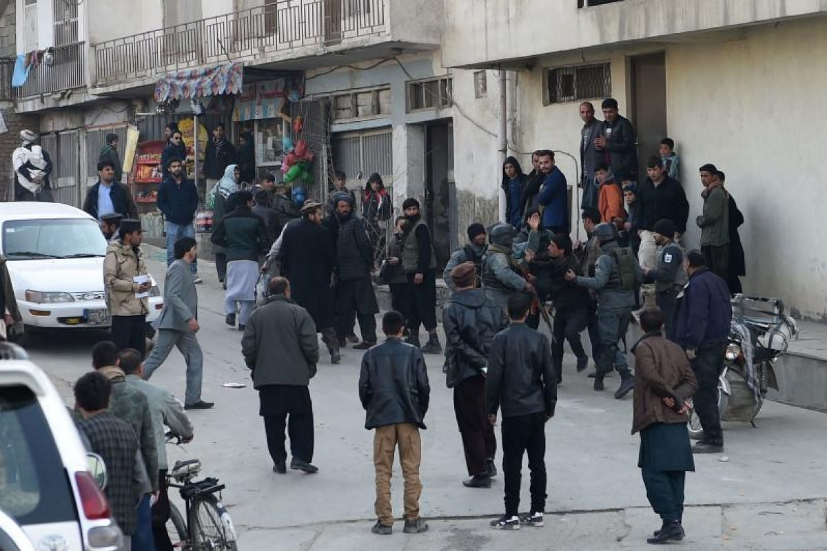 Afghan policemen clash with residents near the Intercontinental Hotel after an attack in Kabul on Jan 21, 2018.