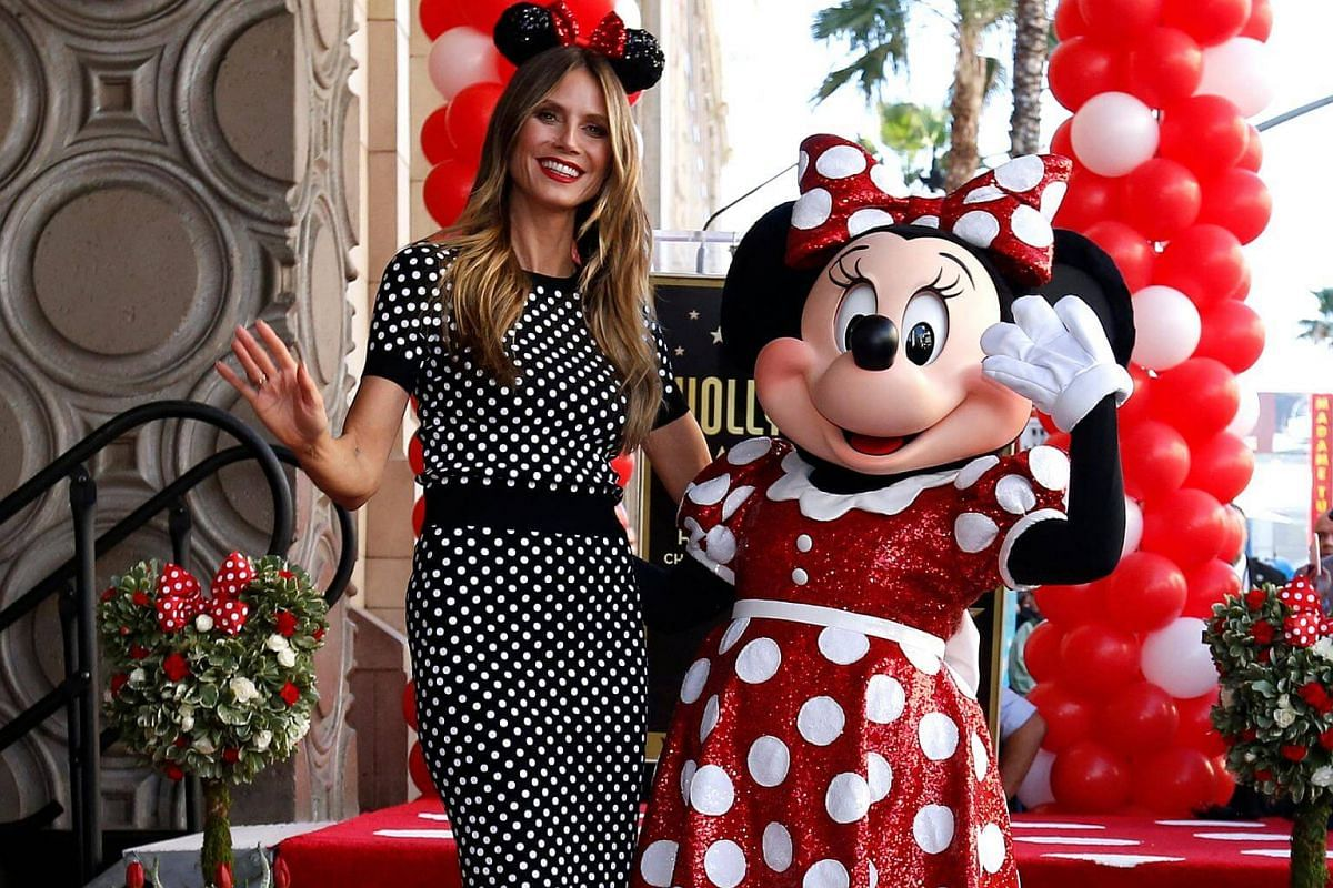 Minnie Mouse poses on her star with model Heidi Klum after it was unveiled on the Hollywood Walk of Fame.