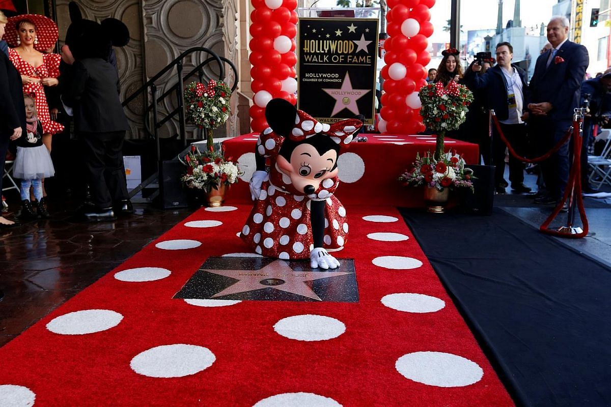 Minnie Mouse poses on her star after it was unveiled on the Hollywood Walk of Fame.