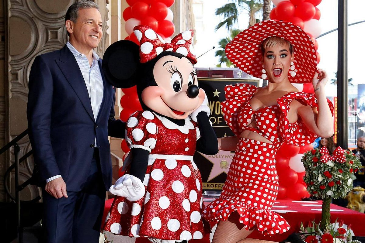 Minnie Mouse, Katy Perry with Chairman and CEO of The Walt Disney Company Bob Iger, posing on the Hollywood Walk of Fame.