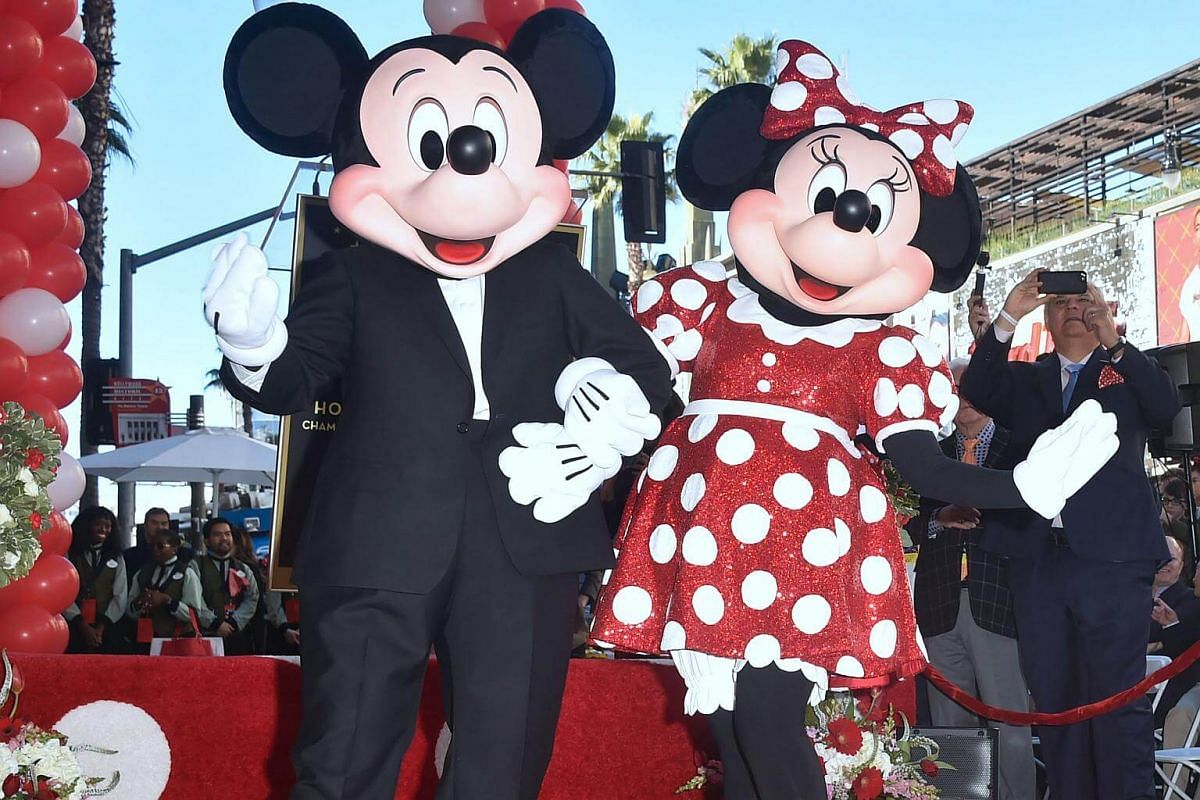 Minnie Mouse poses with Mickey while being honoured with the 2,627th star on the Hollywood Walk of Fame.