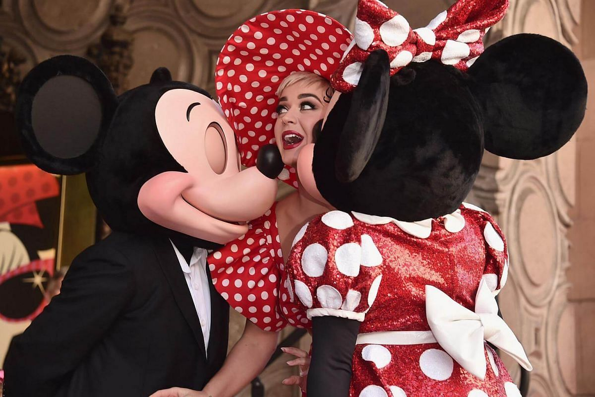 Katy Perry stands on stage next to Mickey and Minnie Mouse during the star ceremony at the Hollywood Walk of Fame.