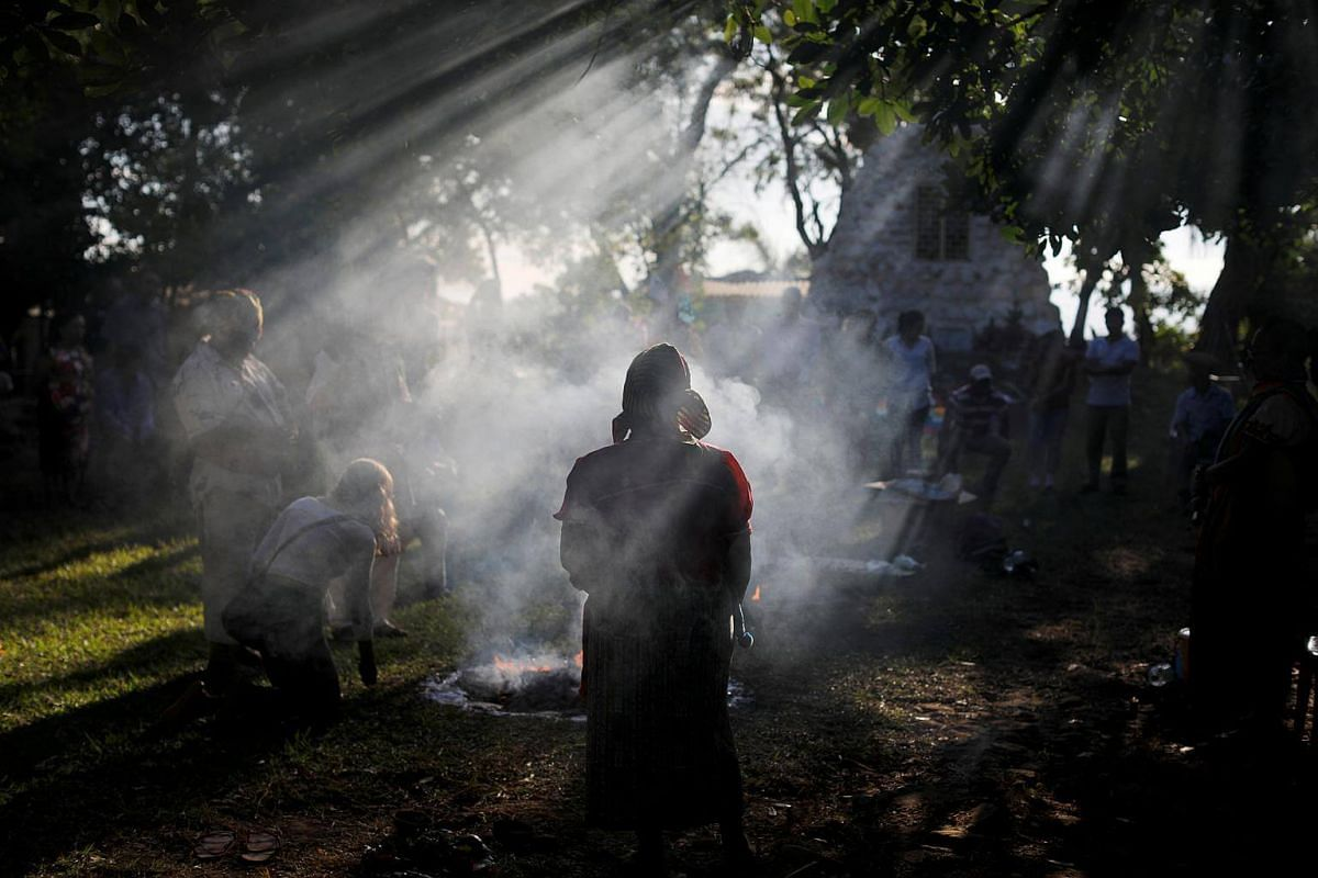 People participate in a traditional ceremony to commemorate the victims of the 1932 Salvadoran peasant massacre in Izalco, on Jan 22, 2018.