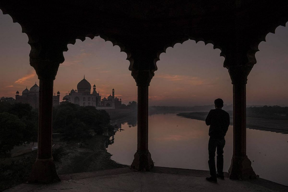 Sunset at the Taj Mahal, where pollution has turned parts of its marble facade yellow and black, in Agra, on Dec 14, 2017.